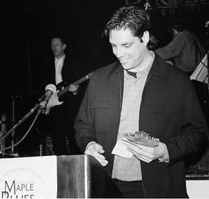 Accepting the Drummer Of The Year Award at the 2001 Maple Blues Awards. Photo: Bill King